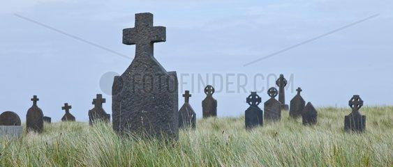 Teachlach Éinne graveyard and church Killeany Village