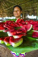 Embera woman and sliced ??watermelon Chagres NP Panama