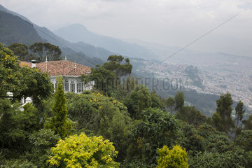 View of Bogota and the Monserrate Forest in the mist  Colombia