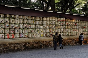 Offering of sake at the entrance of a temple in Tokyo Japan