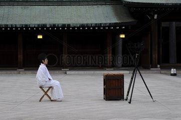 Man meditating in a temple in Tokyo Japan
