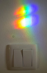 Light refraction on the wall. Spectrum of colours. Light refraction through window glass. Portugal