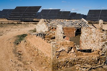 Farm ruin and solar farm in Spain
