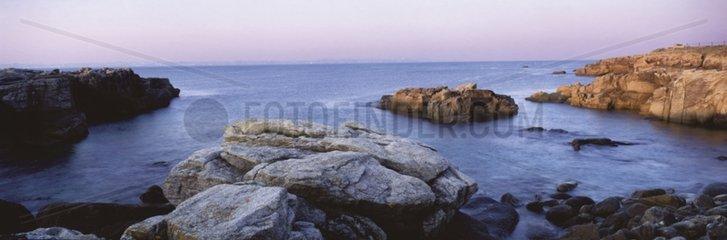 Kerroch's coast and Groix island in summery dawn France