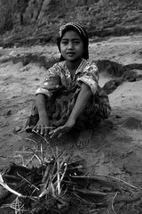 Girl warming by the fire Cambodia