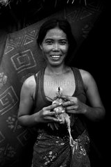 Woman holding a chick village of Otress in Cambodia