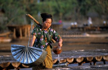 Woman recovering seawater Amed Bali