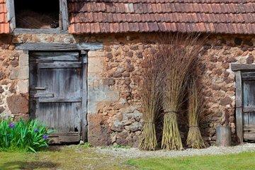 Facade of a Perigord stone farmhouse in the countryside