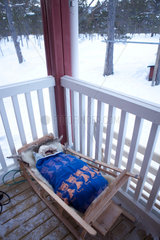 sami baby sleeps outside