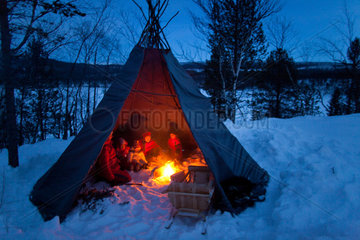 sami people camping in the nroth of finland