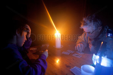 boy and father playing cards in finland