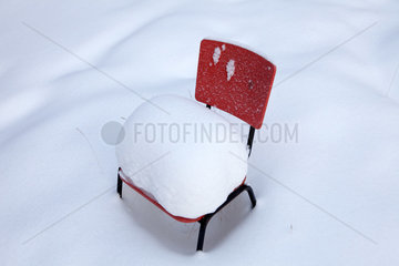 chair with snow in Finland