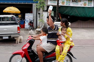 A man takes a drip scooter riding in Cambodia