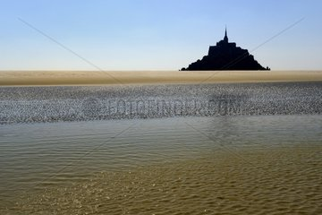 Mont Saint Michel from the bay at rising tide - France
