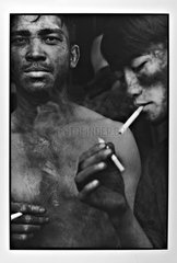 Portrait of minors in cigarette break Vietnam