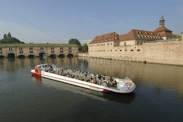 Bateaux Mouches on Ill front of the Vauban dam France