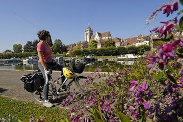 Cyclist on the Véloroute along the Rhone-Rhine canal