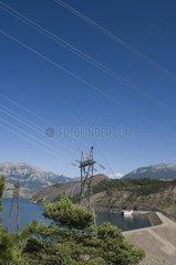 High tension lines on the bank of Serre Ponçon lake France