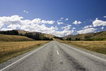 Long straight deserted road New Zealand