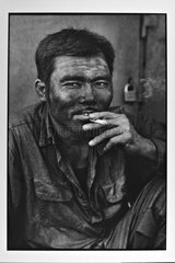 Portrait of a minor during his smoking poses to HongaiVietnam [AT]