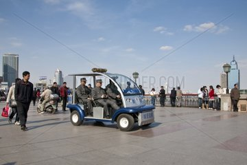 Police in an electric car on the Bund in Shanghai China