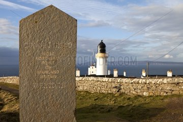 Stele in front of the Dunnet Head Lighthouse Scotland UK