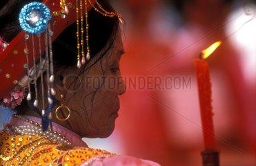 Woman praying Day Serpent Le Mast Hanoi Vietnam