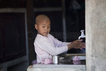 Nun washing hands in Nyaung Shwe Burma