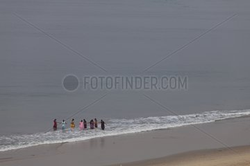 Women bathing in Indian ocean Kerala india