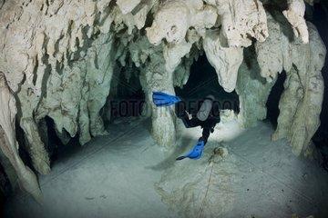 Scuba diver exploring Gran Cenote - Yucatan Mexico