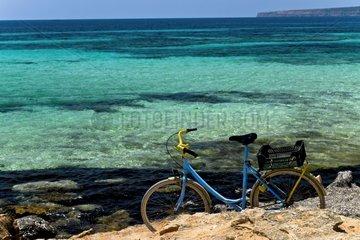 Bike on rocky coast Formentera Balearic