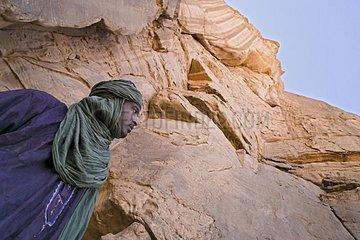 Tuareg near a cliff Tassili N'ajjer Algeria
