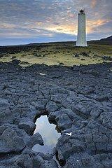Lighthouse at the foot of a lava field volcano Snæfellsjoekull