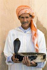 Snake charmer with an Egyptian Cobra Marrakech