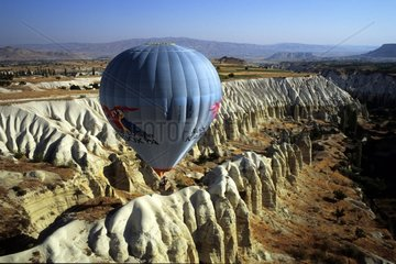 Balloon flying over an eroded valley Cappadocia Turkey