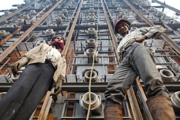 Workers on a ship breaking yards in Bangladesh