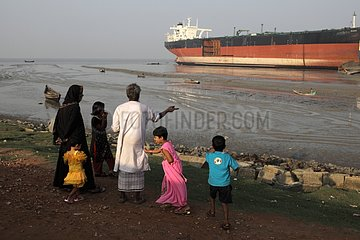 A family outing near a construction site in Bangladesh