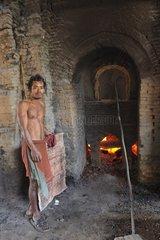 Employee at his brick kiln in Cambodia