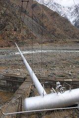 Pipeline on a bridge suspended above the Terek River