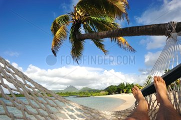 Resting in a hammock on a beach in Mauritius