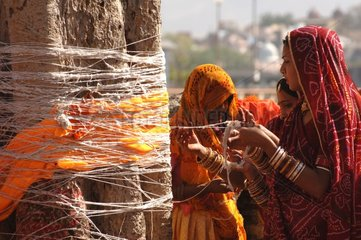Women practicing a ritual to promote birth India