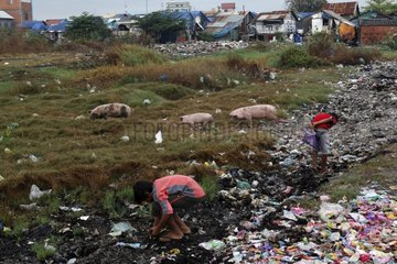 Children seeking metals Discharge Phnom Penh Cambodia