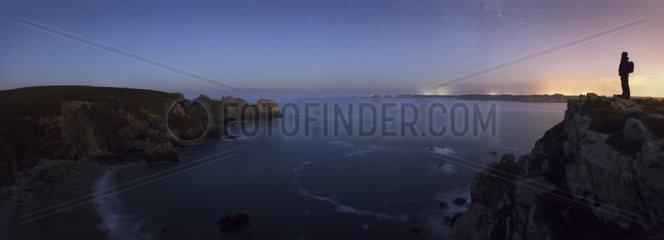 Observant on cliffs of Dinan France