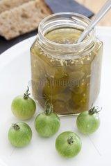 Tomato jam jar green cherries and green cherry tomato