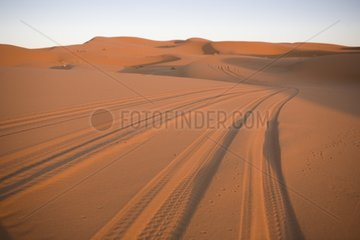 Traces of jeep in the dunes of Merzouga Morocco
