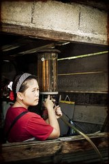 Woman holding a petrol North Thailand