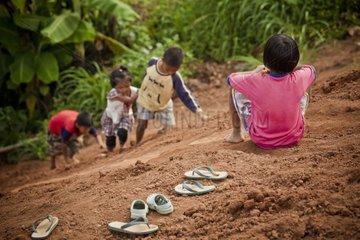 Children playing in the ground near Pai Thailand