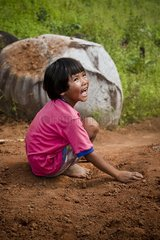 Child playing in the ground near Pai Thailand
