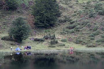 Campers at the Etang de Lers in summer Pyrenees France