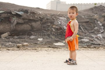 Young boy is in the suburb of Beijing China